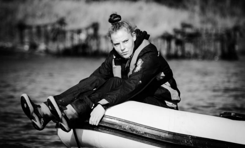 Girl sat on rowing boat